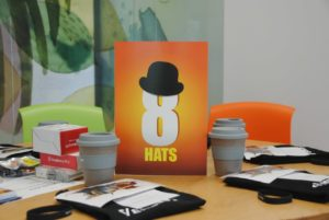 8HATS logo on table