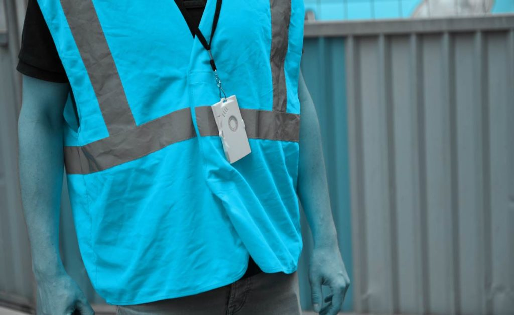Image of Abeeway's Smart badge tracker around neck of construction worker
