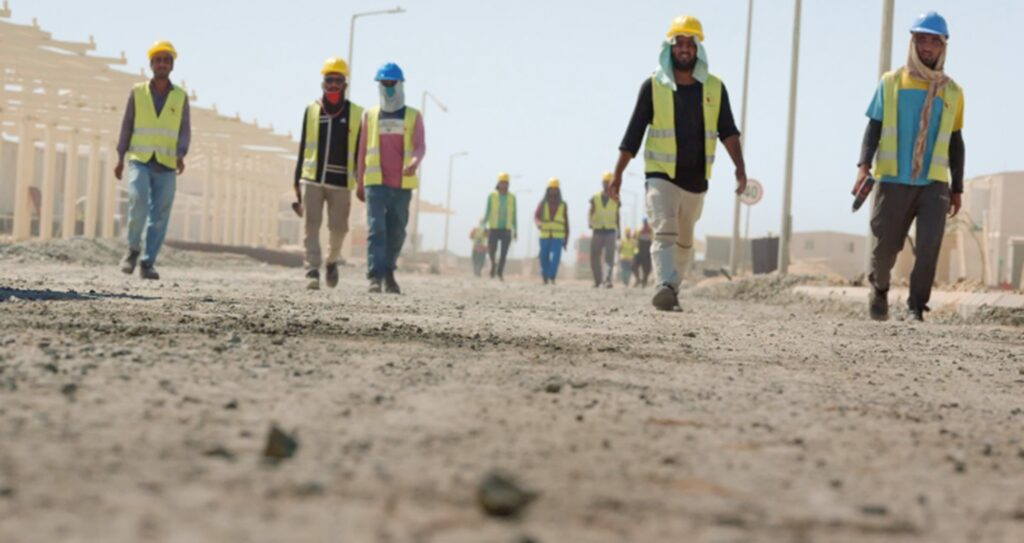 Several workers in sand